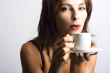 Portrait of beautiful woman drinking coffee Stock Photo - 3976190