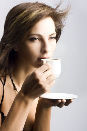 Portrait of beautiful woman drinking coffee photo