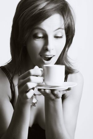 Portrait of beautiful woman drinking coffee Stock Photo - 3982145