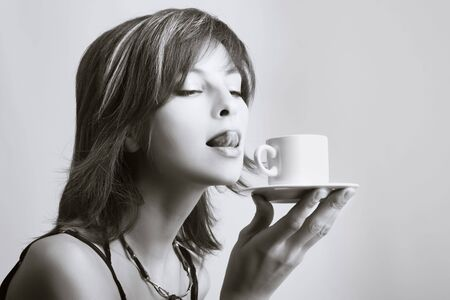 Portrait of beautiful woman drinking coffee Stock Photo - 3982143