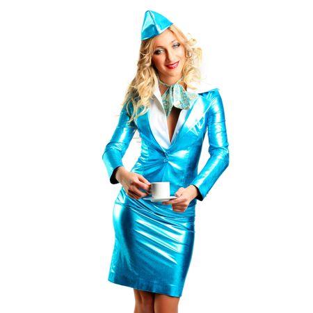 Smiling stewardess. Isolated over white background photo