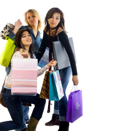 Three girls out shopping. Isolated on a white background photo