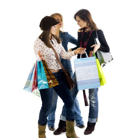 Three girls out shopping. Isolated on a white background Stock Photo - 4356077