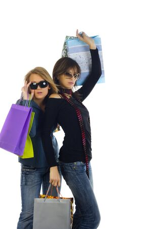 Two girls out shopping. Isolated on a white background photo