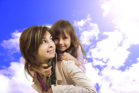 Mother and daughter. On sky's background photo