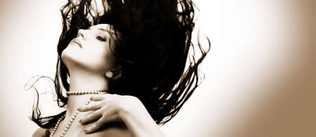 Portrait of beautiful, sexy brunette girl with wind in hair photo
