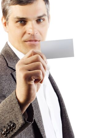 businessman holding blank card. Isolated on white photo
