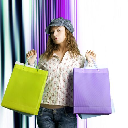 Portrait of young beautiful women with her shopping bags photo