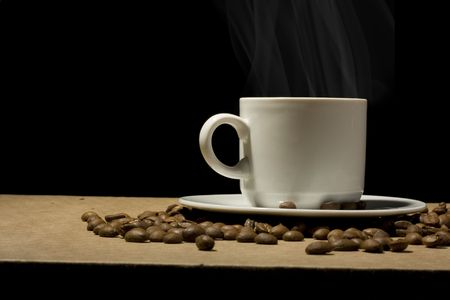 coffeebeans: Cup of hot coffee with coffeebeans