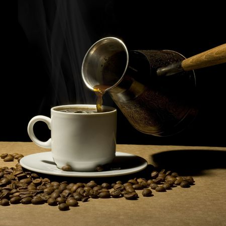 coffeebeans: Cup of hot coffee with coffee pot and coffeebeans Stock Photo