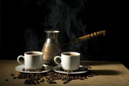 Two cup of hot coffee with coffee pot and coffeebeans