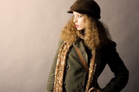 fashion model in autumnwinter clothes. High contrast photo