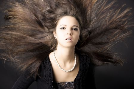 Portrait of a beautiful young woman with luxurious hair Stock Photo - 5759090