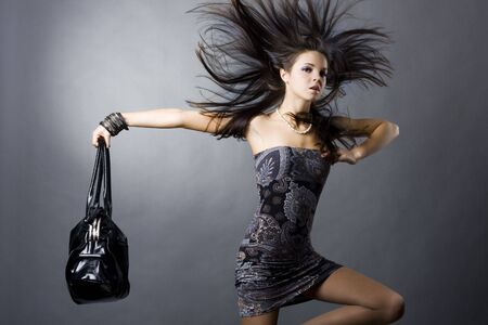 elegance fashion girls look sensuality young: portrait of a girl with a bag Stock Photo