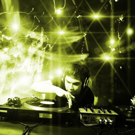 Dj playing disco house progressive electro music at the concert photo