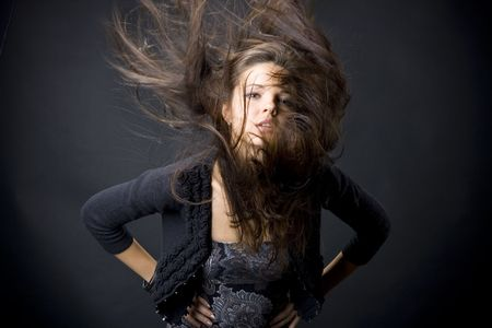Portrait of a beautiful young woman with flying hair Stock Photo - 6314059