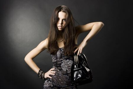 portrait of a sexy girl with a bag Stock Photo - 6314057