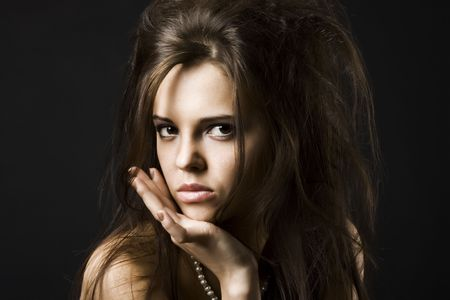 Portrait of a beautiful young woman with dark hair photo