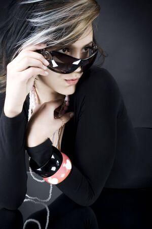 A sexy girl in sunglasses