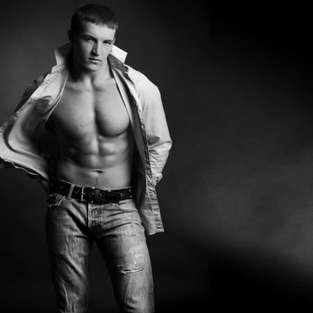 Beautiful young man posing on dark background Stock Photo - 6546255