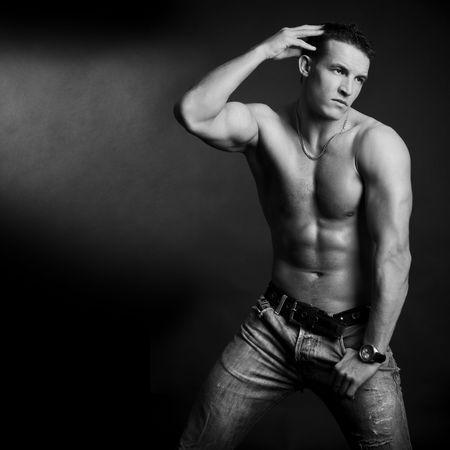 Beautiful young man posing on dark background Stock Photo - 6546248