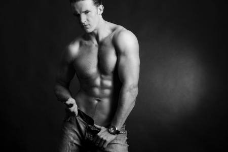 Beautiful young man posing on dark background Stock Photo - 6546226
