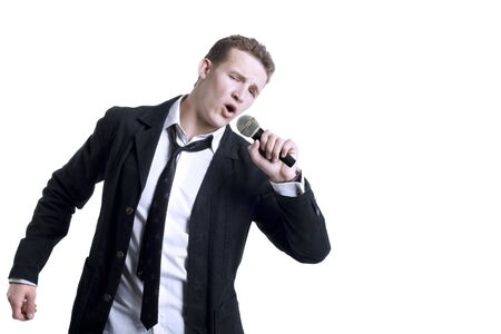 kareoke: Singing Young Man. Isolated on white Stock Photo