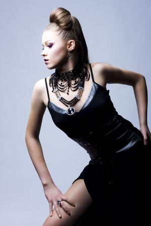 Portrait of a beautiful woman in black evening dress Stock Photo - 6639611