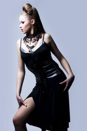 Portrait of a beautiful woman in black evening dress Stock Photo - 6639609