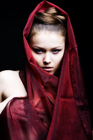beautiful girl enveloped  in red headscarf. Fashion photo Stock Photo - 6639614