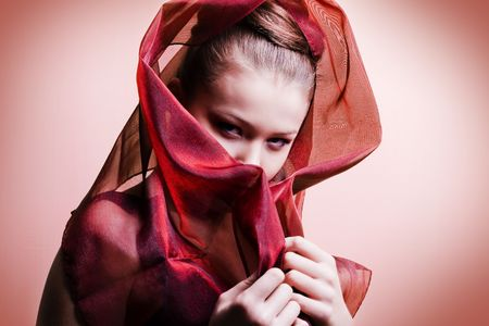beautiful girl enveloped  in red headscarf. Fashion photo Stock Photo - 6639613