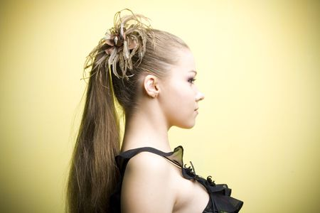 Elegant young blond girl. Profile view Stock Photo - 6644635