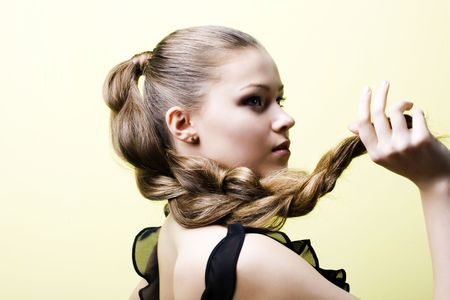 Elegant young blond girl. Profile view