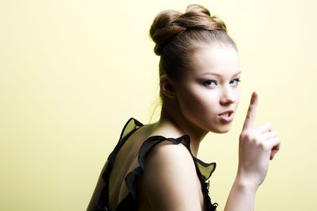 Elegant young blond girl. Profile view Stock Photo - 6644609