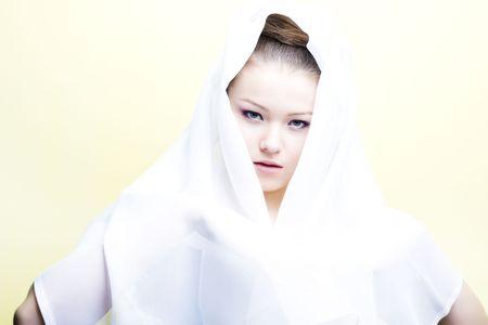 enveloped: beautiful girl enveloped  in white headscarf. Fashion photo Stock Photo
