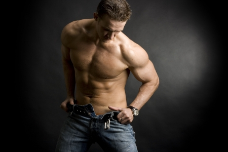 Beautiful young man posing on dark background Stock Photo
