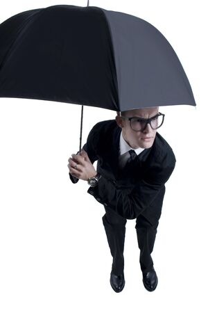 business man hiding under an umbrella. Isolated Stock Photo - 6644605