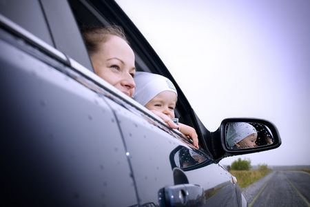 mother and son in a new car Stock Photo