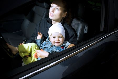 mother and son in a new car photo