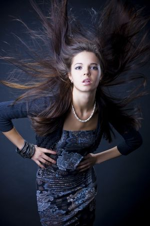 Portrait of a beautiful young woman with luxuus hair Stock Photo - 6644659