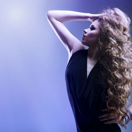 Portrait of the beautiful woman with long curly hair photo