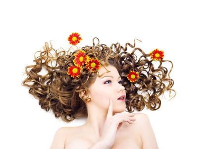Portrait of the beautiful woman with long curly hair and flowers. Isolated Stock Photo - 6736413