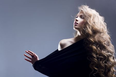 Portrait of the beautiful woman with long curly hair Stock Photo - 6736416
