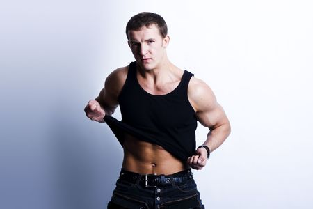 Beautiful young man posing on white background photo