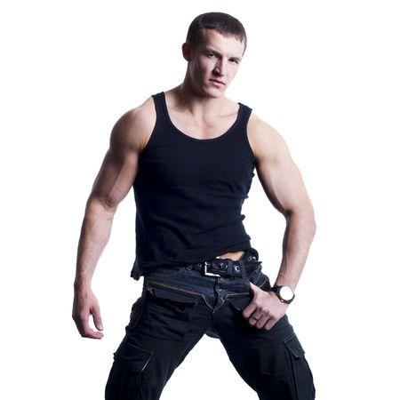 muscle shirt: Hermosa joven posando sobre fondo blanco