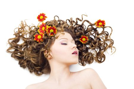 Portrait of the beautiful woman with long curly hair and flowers. Isolated LANG_EVOIMAGES