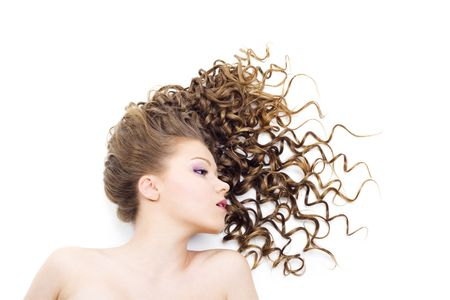 Portrait of the beautiful woman with long curly hair Stock Photo - 6743548
