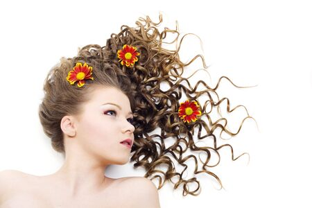 Portrait of the beautiful woman with long curly hair and flowers. Isolated Stock Photo - 6743551