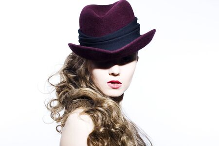 Beautiful young model in hat on the white background. Contrast photo Stock Photo - 6834715