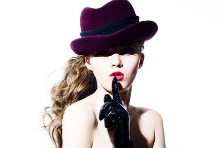 hat nude: Beautiful young model in hat on the white background. Contrast photo